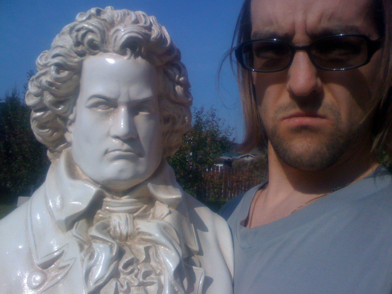 A picture of me and a statue of Beethoven.